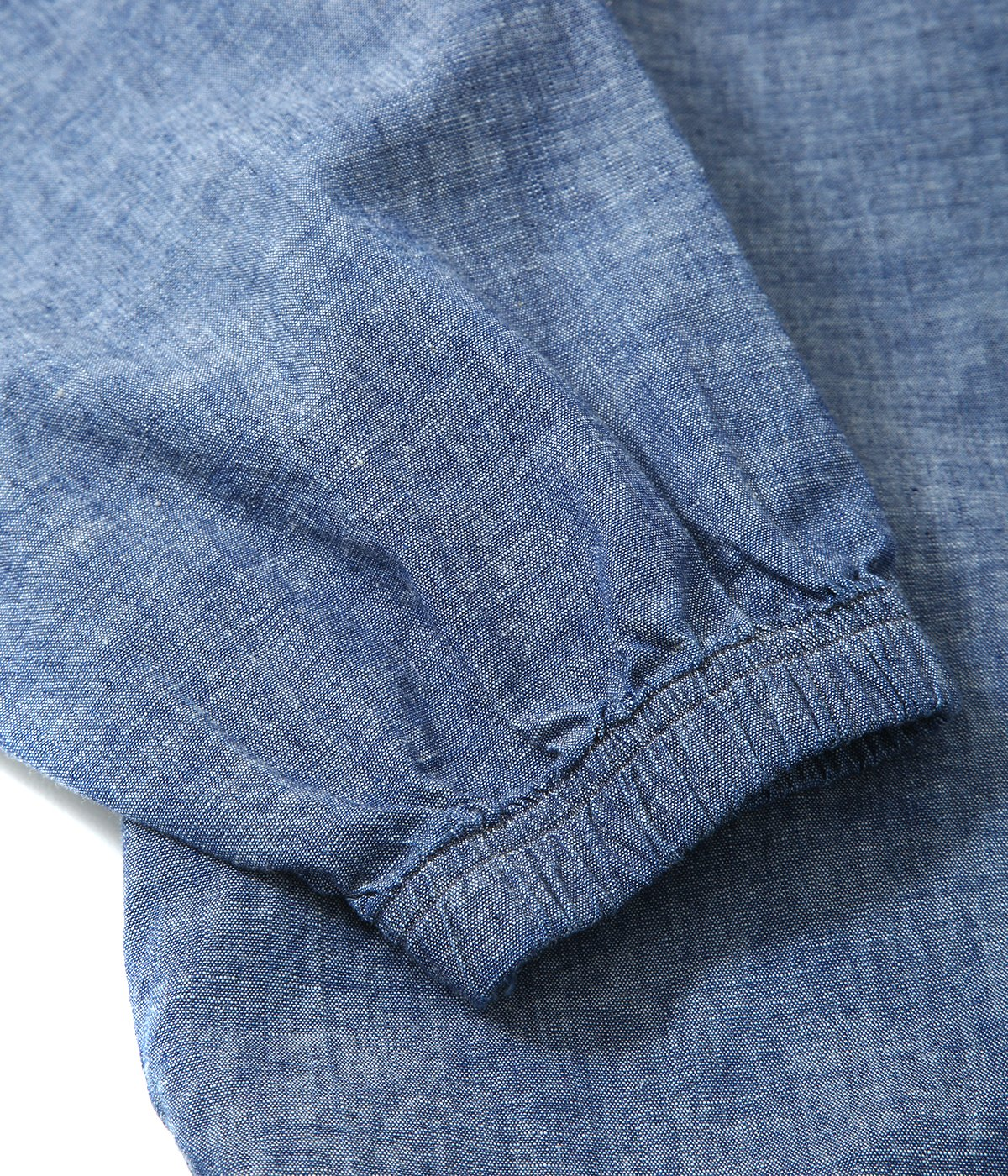 CHAMBRAY NECK PULLOVER