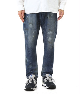 Used paint processing tapered denim pants